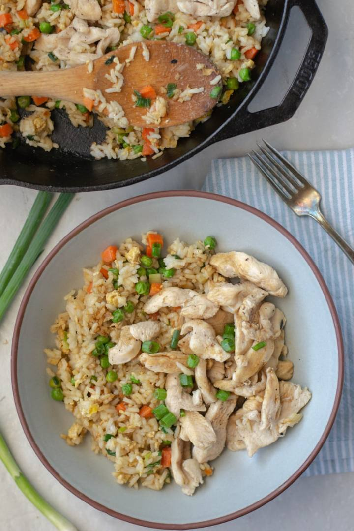 Homemade, better than takeout Chicken Fried Rice is healthier, soy free and awesome for meal prep. These best part is this simple and delicious recipe only takes 20 minutes to make!