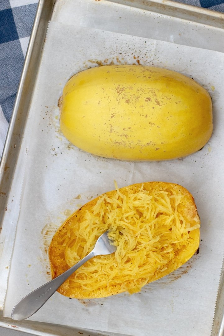 Learn how to cook spaghetti squash in the oven, how many carbs are in this low carb veggie noodle, and tips for how to easily cut it.