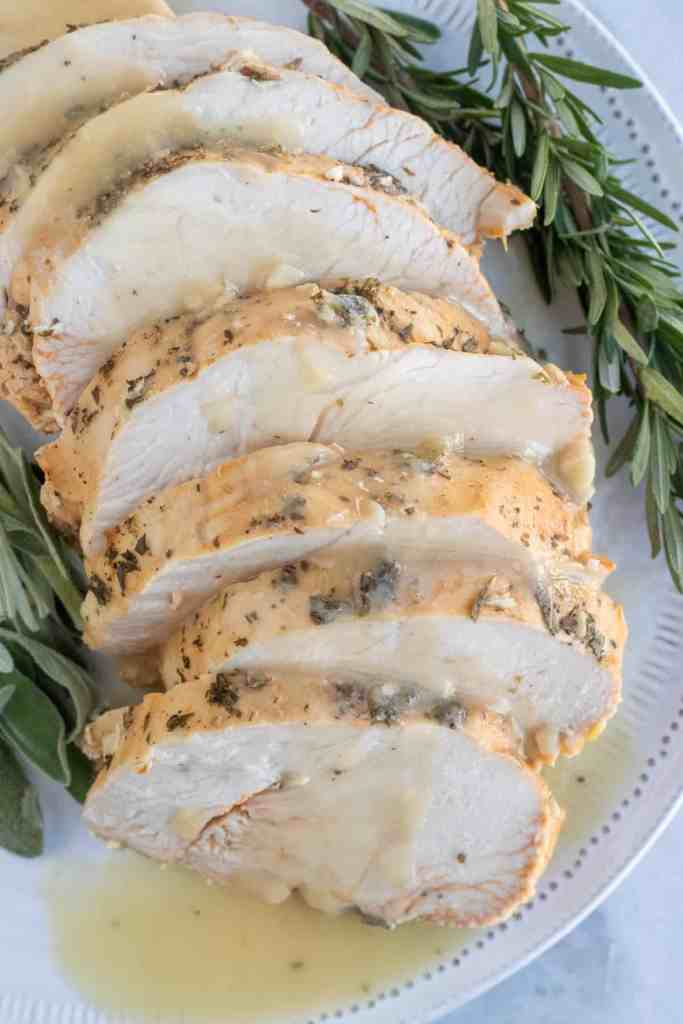 Sliced herb butter roasted turkey breast with gravy.