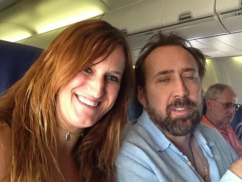 Nic. Cage with a man or a woman not sure .