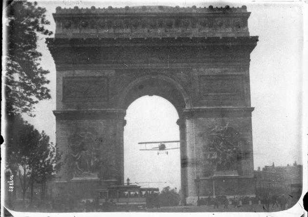 Charles Godefroy flies his biplane through the Arc de Triomphe in Paris on August 7th, 1919
