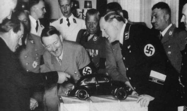 Ferdinand Porsche (yes, THAT Porsche) showcasing the Volkswagen Beetle to Adolf Hitler in 1935