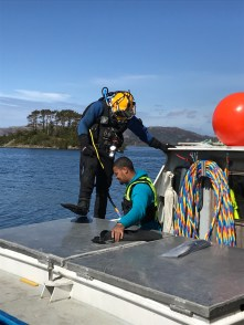 Commercial divers prepare to work.