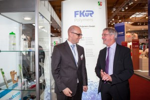 Fakuma 2015: State Secretary Dr. Günther Horzetzky together with our Managing Director Christian Dohmen