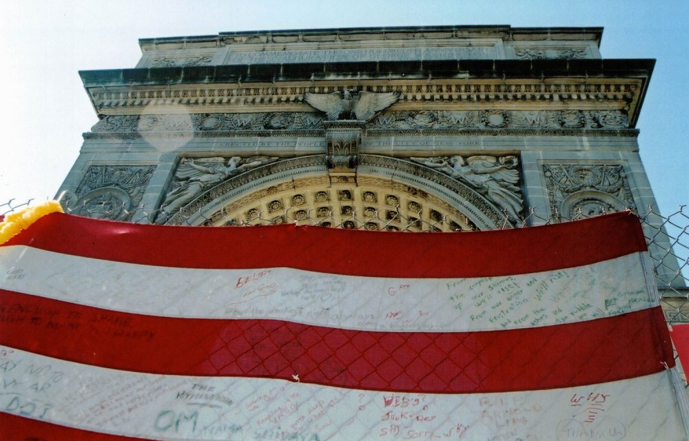 In Washington Square Park in Manhattan, an American flag turned emotional message board in the days after the 9/11 attacks. (© Pierre Tristam/FlaglerLive)