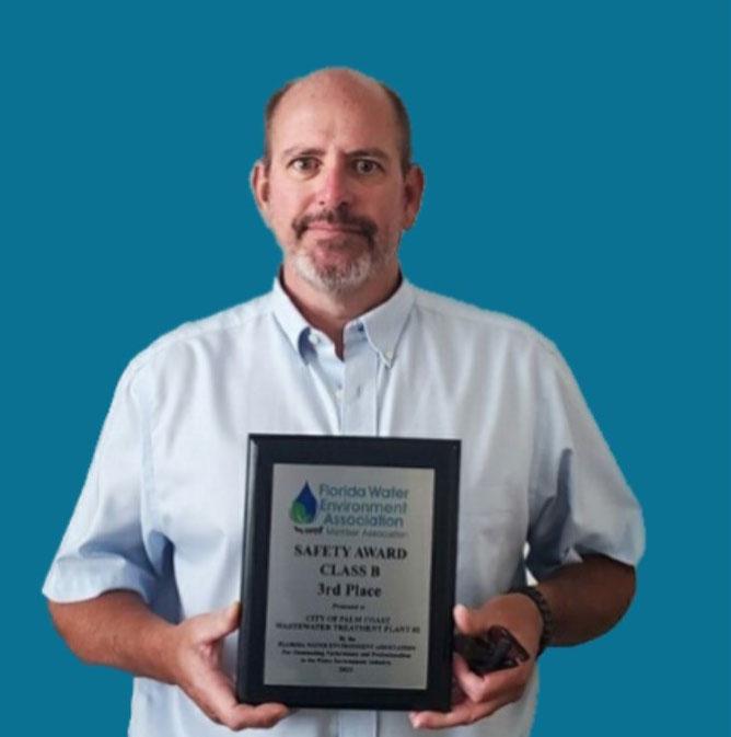 Pat Henderson with the award. (Palm Coast)