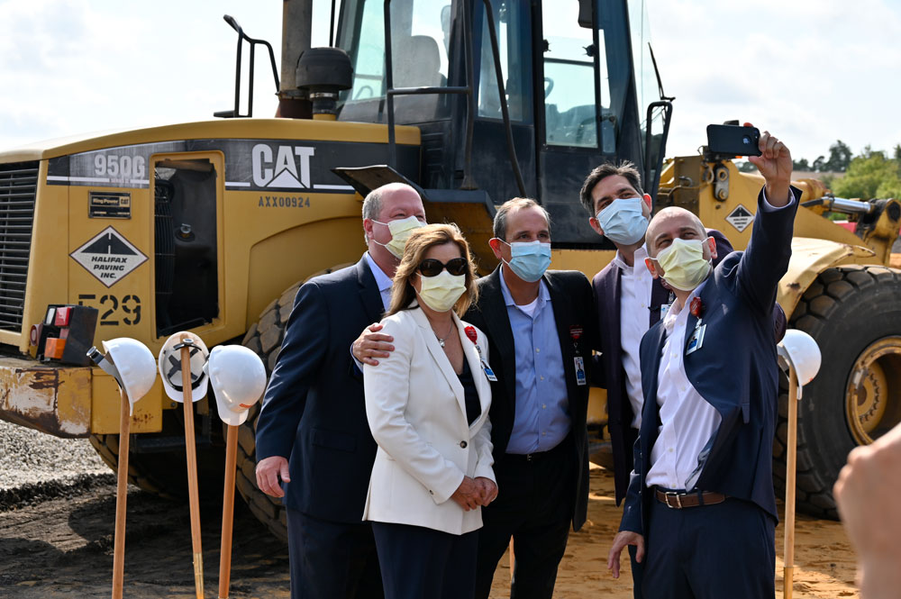AdventHealth's top executives after filming today at the 11-acre site oif the new, $145 million hospital and medical office building on Palm Coast Parkway. From right, AdventHealth Palm Coast COO Wally de Aquino, Central Region CEO David Ottati, AdventHealth Palm Coast CEO Ron Jimenez, Chief Nursing Officer Kathy Gover, and Chief Financial Officer Mark Rathburn. (© FlaglerLive)