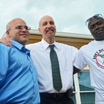 Seth Penalver, left, was on death row for almost 19 years before his exoneration and release in 2013. Herman Lindsay, right, was exonerated several years ago before Penalver. They are seen here with Mark Elliott, who heads Floridians for Alternatives to the Death penalty. (© FlaglerLive)