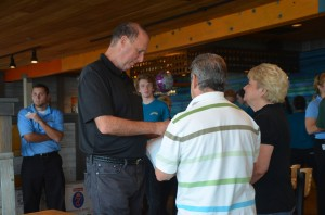 Ray Barshay spoke with George Hanns, the county commissioner, who was one of his first guests at the Funky Pelican Wednesday. Barshay had not met Hanns before. (c FlaglerLive)