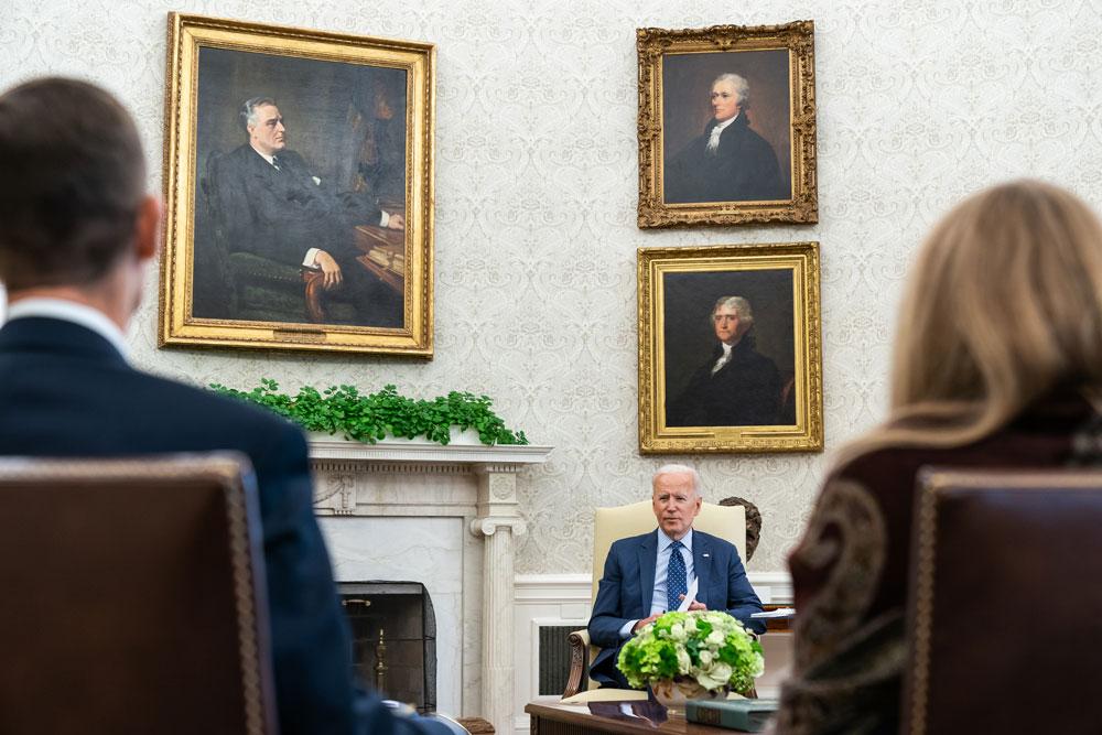 President Joe Biden meeting with staff in June. (White House)