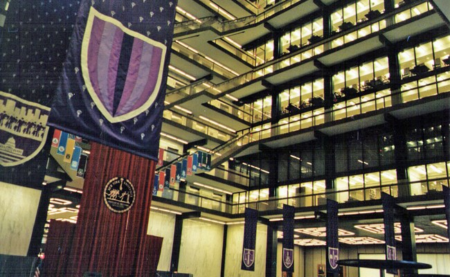 One of the wonders of the world: Bobst Library at New York University. It was designed by Philip Johnson and Richard Foster. It contains more than 4 million volumes and seats 2,500. When plans for the library were first announced in 1966, it was to cost $17 million. By 1971, the cost had soared to $24 million. When it was dedicated in December 1972, after years of controversy, costs had soared to $25 million, the equivalent of $147 million in 2014 dollars. It would not open until September 1973. Elmer Bobst was a self-taught man who started as a $3-a-day clerk in a drug store and became president of the Hoffman-LaRoche drug company from 1928 to 1944, then headed Warner-Lambert, now Pfizer, until 1967. He was a close friend and adviser to President Nixon. He died in 1978, at age 94. (© FlaglerLive)