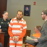 Joseph Bova, center, with his attorney, Joshua Mosley, right, in Bova's last court appearance in April. He has been at the Flagler County jail since, but his mental state is unclear. (© FlaglerLive)