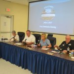 Bunnell city commissioners shortly before their vote to end the Sheltering Tree's operations of the cold-weather homeless shelter on Pine Street. The Justice Department investigation of the city will now burden City Attorney Wade Vose, left. (© FlaglerLive)