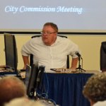 Bunnell City Commissioner Jan Reeger, left, didn;t get far as fellow-Commissioner John Rogers, center, then Mayor Catherine Robinson shut down Reeger's latest attempt to fire City Manager Alvin Jackson Monday evening. (© FlaglerLive)