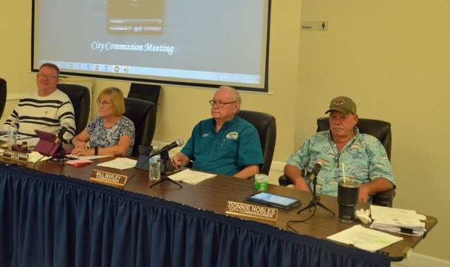 The Bunnell City Commission has been an oasis of calm through the pandemic. From left, Commissioner John Rogers, Mayor Catherine Robinson, Commissioners Bill Baxley and Donnie Nobles. Commissioner Tonya Gordon is not pictured. Baxley is stepping down. Nobles has been absent, and his future on the commission is uncertain. (© FlaglerLive)