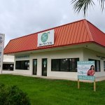 Flagler Tax Services operated for many years at the Bunnell Business Center, which includes the Chicken Pantry. The center was for sale. (© FlaglerLive)