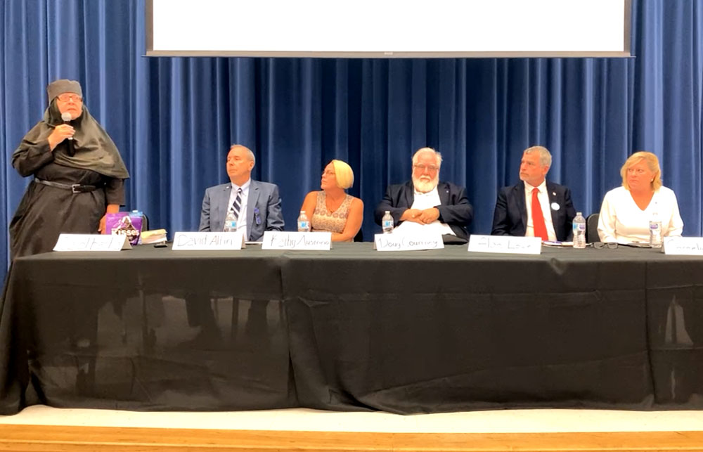 The candidates in a screen capture from the News-Journal's social media video of the forum at Buddy Taylor Middle School. From left, Carol Bacha, David Alfin, Kathy Austrino, Doug Courtney, Alan Lowe and Cornelia Manfre.