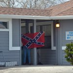 Teens brandished a confederate flag on the grounds of the city's Freeda Zamba pool Sunday afternoon, next to Belle Terre Park, where bigoted and obscene graffiti had been spray-painted. (© FlaglerLive)
