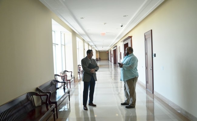 Eric Cooley, left, speaking with News-Journal report Matt Bruce this morning outside the courtroom, just after the charge against Cooley was dropped. (© FlaglerLive)