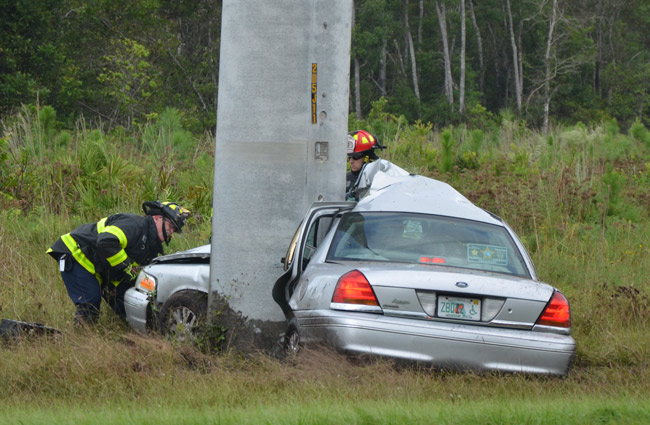 The Ford wrapped itself around the high-power utility pole off U.S. 1. (© FlaglerLive)