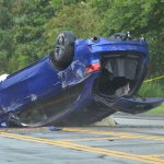The Accura flipped on Royal Palms Parkway just past Point Pleasant Drive at midday Monday. (© FlaglerLive)