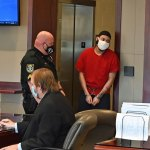 Marion Gavins Jr., right entering the courtroom this morning before his plea and sentencing. (© FlaglerLive)