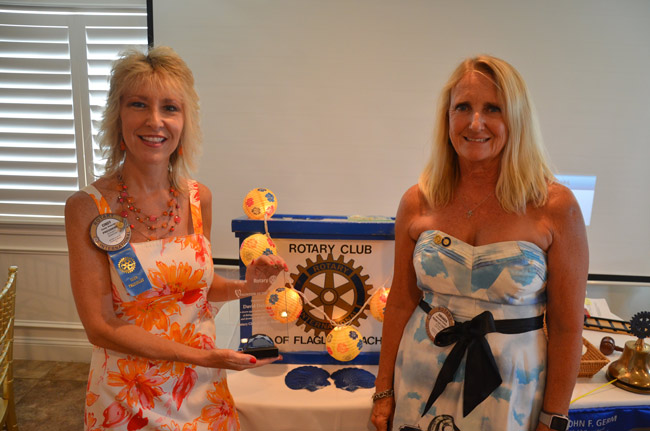 Cindy Dalecki, left, with the Flagler Beach Rotary's new Volunteer of the Year Award, which earlier this month was awarded to the late Dave Dalecki, Cindy';s husband. The award is to be known henceforth as the Dave Dalecki Volunteer of the Year Award. Cindy Dalecki is the Rotary's past president. Amanda Bailey, right, was installed as this year's president. Roseanne Stocker was named the Rotarian of the Year and Tom DeCeglie the Citizen of the Year. (© FlaglerLive)