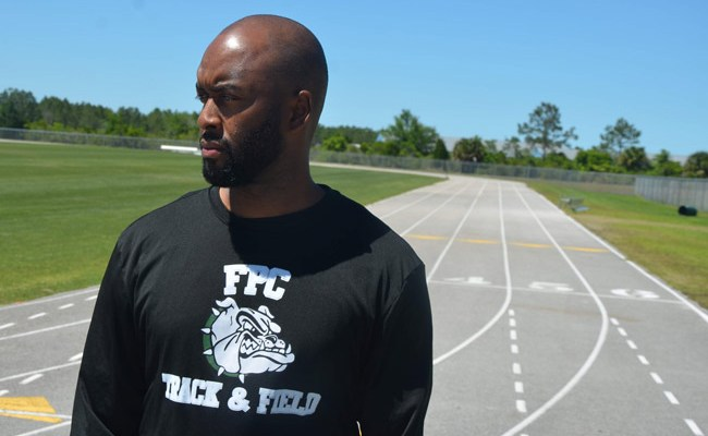 Coach Derrick Griffin, seen here at Indian Trails Middle School, where he works, coaches PAL track and was asked to remove the FPC shirt he wore while on Matanzas High School's track. (© FlaglerLive)