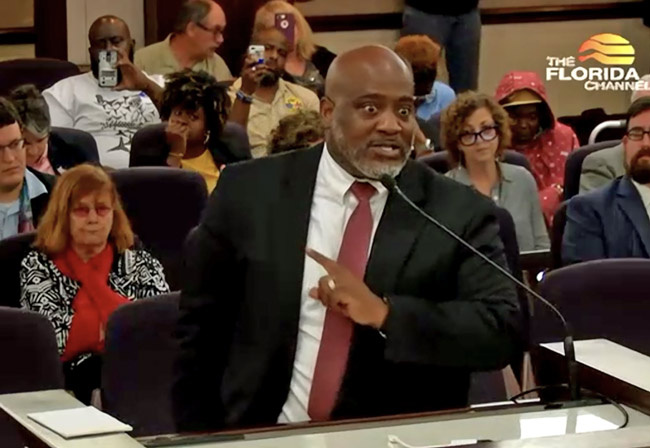Desmond Meade, executive director of the Florida Rights Restoration and chair of the sponsoring committee of Amendment 4 for Floridians for a Fair Democracy, addressing the Senate committee today. (© FlaglerLive cia Florida Channel)