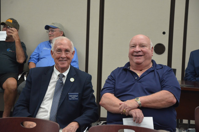 Old rivals, but not really: County Commissioner Charlie Ericksen, right, and former Palm Coast Mayor Jon netts at Friday's legislative delegation meeting at Palm Coast City Hall. Ericksen challenged Netts for the Palm Coast mayorship in 2011, lost, then won a seat on the County Commission in 2012, and won re-election last year. (© FlaglerLive)