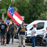 Far-right extremists, some in camouflage, some belonging to the Three Percenters, the anti-government militia, preparing to enter the Flagler County School Board meeting last month in Bunnell. (© FlaglerLive)
