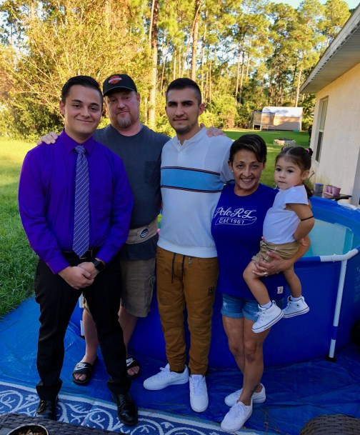 Anthony Fennick, center, with his family in Palm Coast: his brother and father, both of whom are called Dan, his mother Ericka Williams, and his daughter Eva. (Williams family)