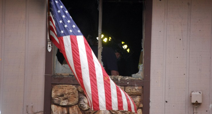 The fire started on the bed in the bedroom of the unit at The Village. Somehow, Old Glory escaped with only a few scrapes. (© FlaglerLive)