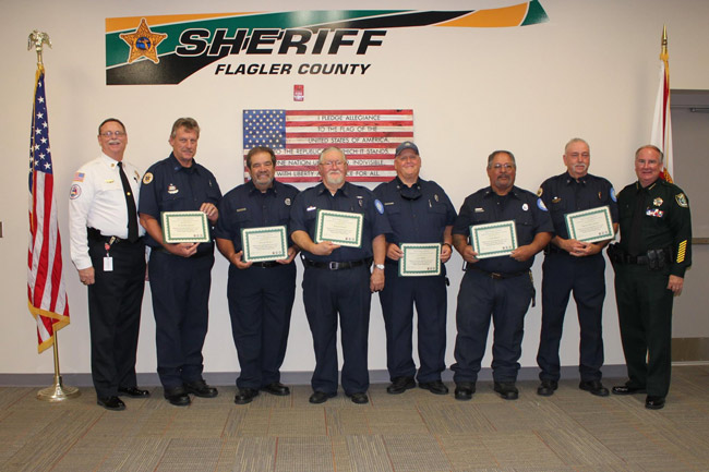From Palm Coast Volunteer Fire and Rescue: 'The Palm Coast Fire Police were recently honored by the Flagler County Sheriff's Office & Sheriff Rick Staly. The Palm Coast Fire Police assist with traffic control at motor vehicle crashes, fire scenes and emergency incidents. This selfless group of volunteers respond to over a thousand calls for service a year. We appreciate their commitment and dedication.' From left, Fire Chief Michael Beadle, Lt. Rick Stevens, Vinny DeVita, Robert Hudak, Jack Ogden, Felix Lucas Ramos, Captain Steve Garnes, and Sheriff Rick Staly. (Facebook)