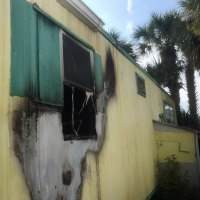 The fire destroyed a back bedroom at the doublewide trailer. Click on the image for larger view. (Flagler Beach Fire Department)