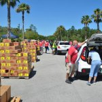 The massive food distribution Palm Coast government organized on May 2, 2020. It would turn out to be the only one organized by a local government, though weekly distributions took place before and have continued to take place since through Grace Community food pantry on Education Way. (© FlaglerLive)