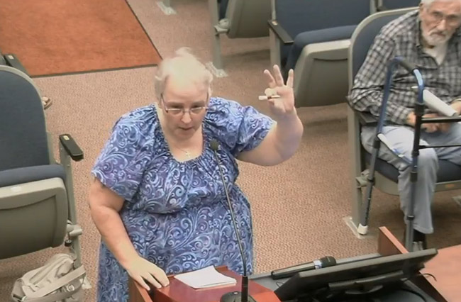 Patricia Freytag holds up an object to show Flagler County Commissioner what a medical marijuana product looks like.