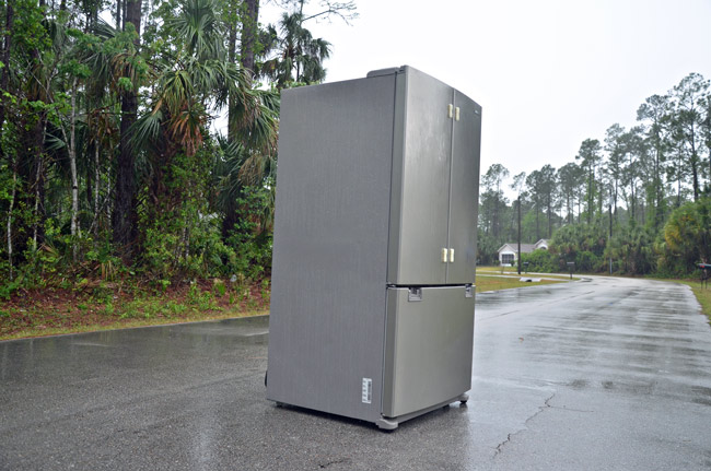 Monday marked the 49th anniversary of the release of '2001: A Space Odyssey.' On Wednesday, the famous monolith returned, it seems, but in the form of a fridge, lost on a P-Section street in Palm Coast. It did not linger. (© FlaglerLive)