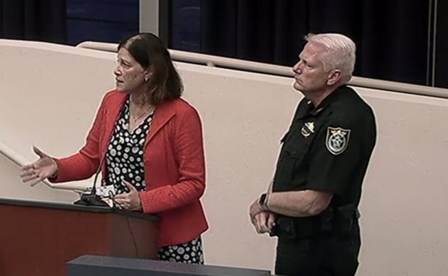 School Board attorney Kristy Gavin and Sheriff's Chief Mark Strobridge had negotiated the deal on behalf of their vrespective agencies, and presented the final contract to the school board this evening. (© FlaglerLive via Flagler TV)
