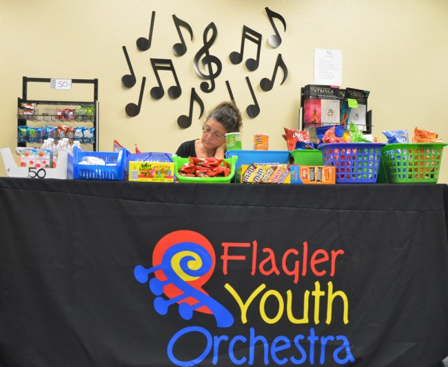 Helene Cangialosi, parent of two students enrolled in the Flagler Youth Orchestra, at the end of the day behind the Suite Shop, concessions that help defray the cost of the program, which enrolled some 400 students as it kicked off Monday. (c FlaglerLive)