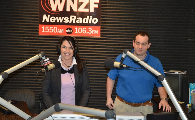 Milissa Holland and WNZF engineer Marc Gilliland when Holland was taping her radio show in 2012. The paiur is at work again preparing 'Discover Palm Coast,' Holland's new weekly radio show, starting in March. (© FlaglerLive)