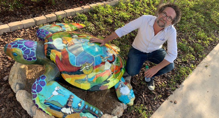 Palm Coast and Bunnell artist JJ Graham, owner of Salvo Art in Bunnell, with turtle a la degas (© FlaglerLive)