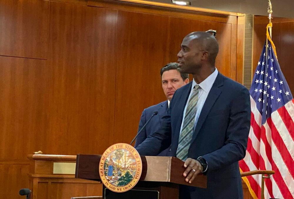 Dr. Joseph Ladapo was announced on Sept. 21, 2021, as Florida's new surgeon general. Behind him is Gov. Ron DeSantis. (Michael Moline)