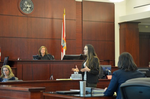 Circuit Judge Margaret Hudson, listening to defense attorney Ashley Kay's opening arguments, is presiding over the trial. She denied a defense motion for mistrial at mid-morning. Click on the image for larger view. (© FlaglerLive)