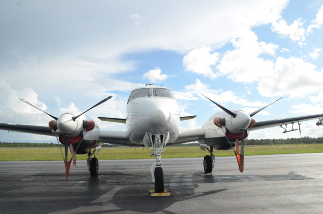 One of the two Clarke Mosquito Control turboprop planes that will fly over Flagler over the next two nights was parked at the Flagler County Executive Airport late this afternoon. A second was joining it at 6:30 p.m. (© FlaglerLive)