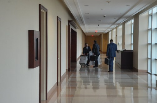 The Wykretowicz team of lawyers leaving at the end of the day: Sam Masters, left, Aaron Delgado and John Reed. (© FlaglerLive)