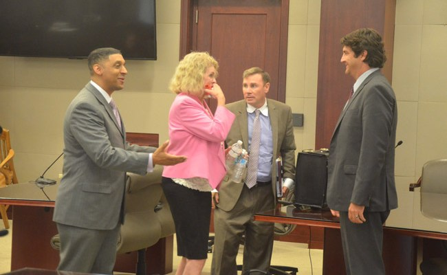 Lucille Horton with her lawyers after the verdict late this afternoon. From left, Marc Dwyer, Doug Williams and Ron Hertel. (© FlaglerLive)