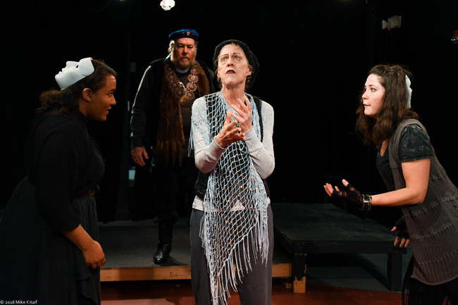 """Macbeth (Robert O. Dimsey, rear) encounters three witches (from left, Phillipa Rose, Victoria Page and Kendra Lyons) in the City Repertory Theatre production of Shakespeare's """"Macbeth."""" The play will be staged Feb. 22-25 as a Shakespeare in the park production in conjunction with the Palm Coast Arts Foundation. (Mike Kitaif)"""