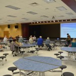 Marilyn Crotty leads the second of four Palm Coast charter review workshops earlier this month at the Indian Trail Middle School cafeteria, where, as has been the case at all three workshops, few people turned up. (© FlaglerLive)