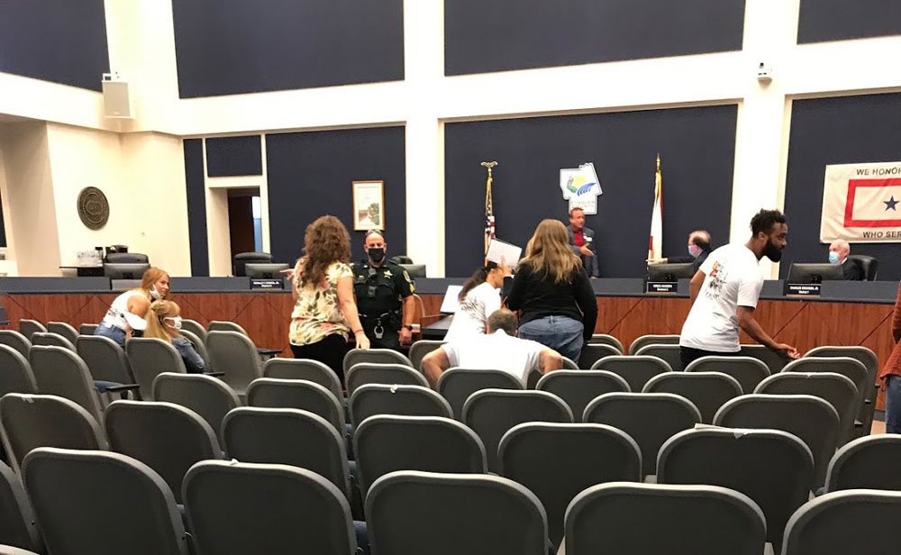 A group of anti-mask militants was asked to leave the county commission meeting this morning unless its members wore mask. Some of them eventually addressed the commission, then were asked to leave the chamber. (© FlaglerLive)